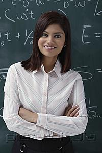 PictureIndia - Teacher leaning against chalk board