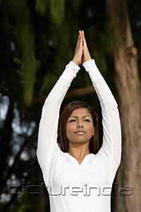 PictureIndia - woman practicing yoga outside