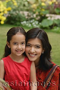 Asia Images Group - mother and daughter in garden, close up, smiling at camera