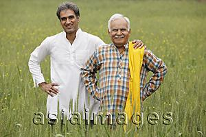 Asia Images Group - father and son farmers in field