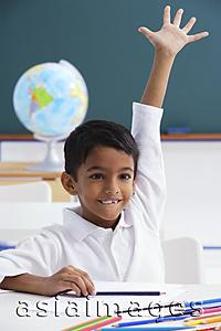 Asia Images Group - boy raises his hand excitedly