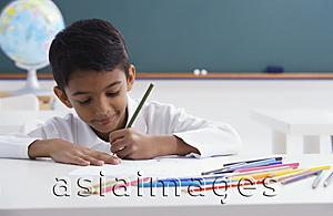 Asia Images Group - boy concentrates on schoolwork