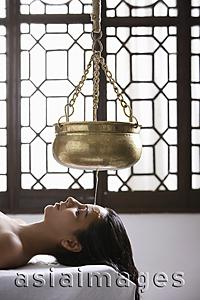 Asia Images Group - young woman having Ayurvedic spa treatment