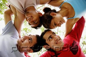PictureIndia - Circle of friends, arms around each other, looking away