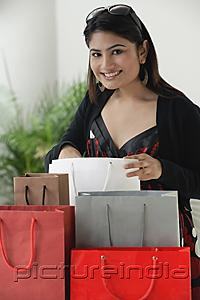 PictureIndia - Woman surrounded by shopping bags